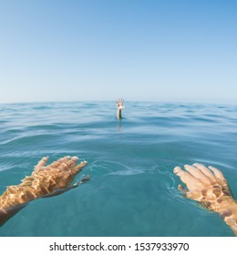 hand of drowning man in sea water from witness point of view