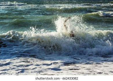 Hand of drowning man trying to swim out of the stormy ocean.  Drowning victim needing help, asking for help. Failure and rescue concept.