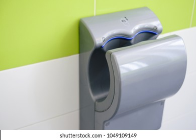 Hand dryer in public WC, closeup