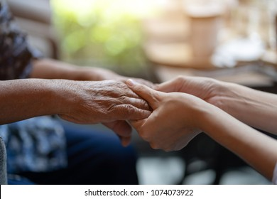 Hand of elderly woman holding hand younger woman, Helping hands, take care for the patient concept.