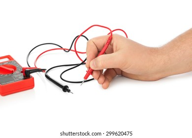 Hand and electric multimeter isolated on white background