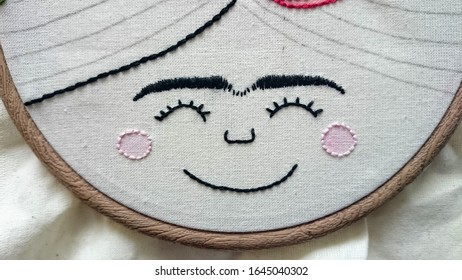 Hand embroidered face inspired on Frida Kahlo