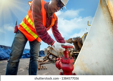 hand of engineer motorman or fireman opening or closing water valve in fire fighter in jobsite  during training or inspecting,  Fire fighting checking in safety priority