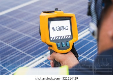 hand of engineer using thermal imager to check temperature heat of solar panel