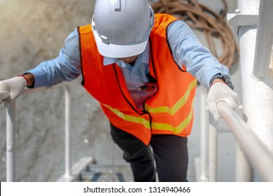 hand of engineering, technician, motorman, or machanic holding handrail in hurry upstiar running,  to reach destination in time, working at risk in high level of insurance