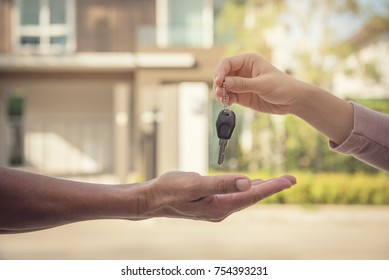 Hand of estate agent giving home keys to person, Independent man purchasing new home.