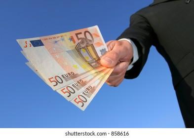 hand with euros against blue sky