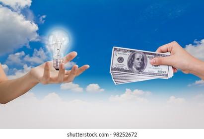 Hand exchange Idea (Bulb)with Dollar over blue sky
