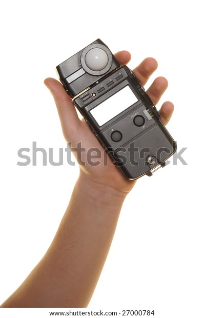 hand with exposure meter over white background