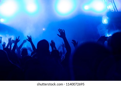 Hand fans during a concert