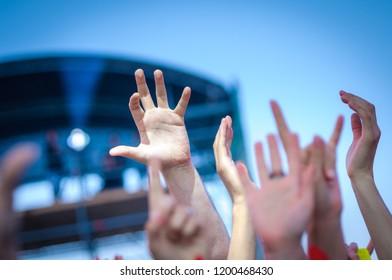Hand fans during a concert. Open air festival