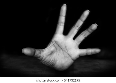 hand of Fear woman being abuse on ground with man on her body and holding her hairs ( abuse concept, sexual abuse)with black shadow  in white tone