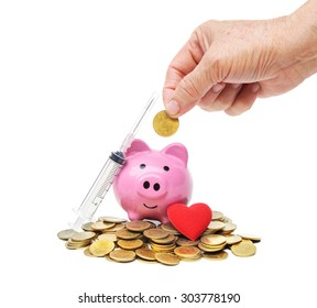 hand of a female elderly putting golden coin into a pink piggy bank with syringe, and red heart - The elderly saving money for healthcare