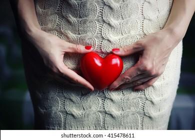 Hand female holding intim heart