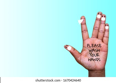 A hand with finger faces wearing face masks with one finger sneezing, please wash your hands text on hand, with copyspace, washing your hands with soap to stop infection spreading concept