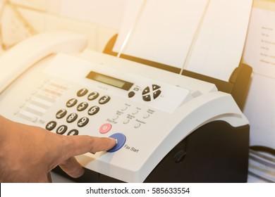 hand finger press transmitter fax send document is office equipment