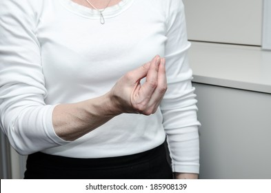 hand with  fingers gesture on white background