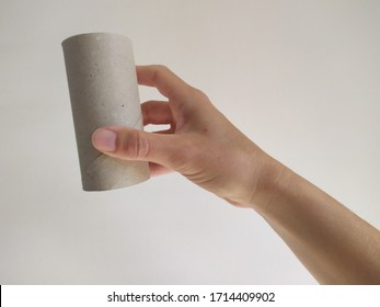 hand with finished toilet roll
