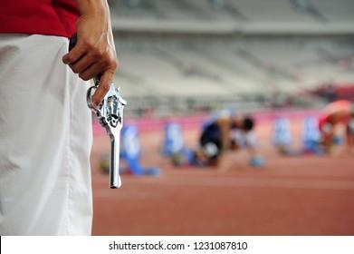 Hand firing a gun for starting race
