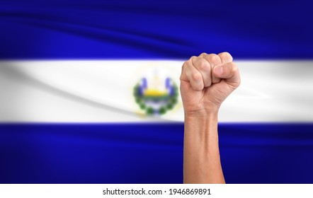 Hand Fist with background the EI Salvador Flag - Shutterstock ID 1946869891