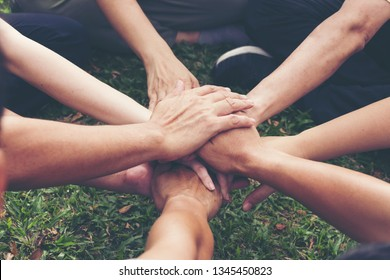 Hand fist touching together in circle shap,show power of cooperation.