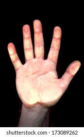 hand and flat on the dark background