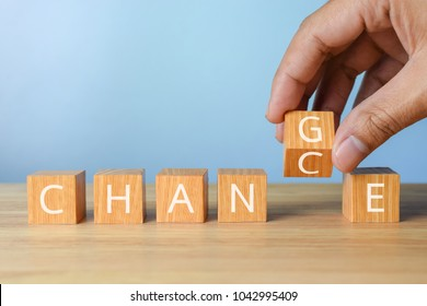hand flip wooden cube with word change to chance career growth or change and personal development