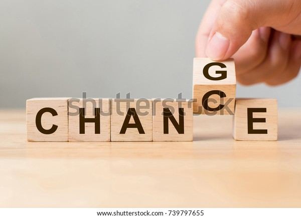 Hand flip wooden cube with word change to chance, Personal development and career growth or change yourself concept