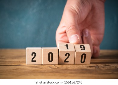 hand flipping two cubes with year 2019 to 2020