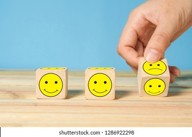 hand flipping unhappy turning to happy symbol, making customer good experience concept