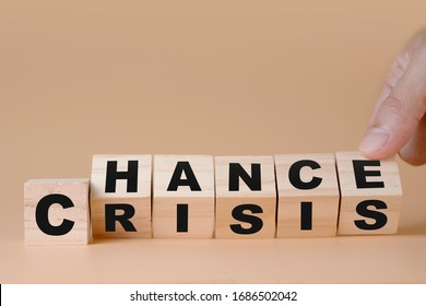 """Hand flipping wooden cubes for change wording"""" Crisis """"  to """" Chance"""".  Mindset is important for human development."""