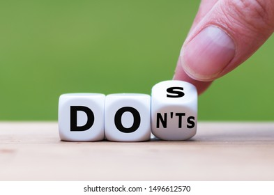 "Hand flips a dice and changes the expression ""don'ts"" to ""does"""