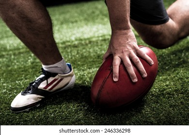 Hand of football player making touchdown