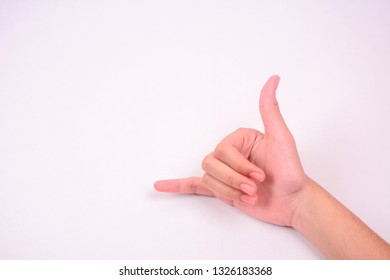 A hand forming a call shape symbol isolated against white background.