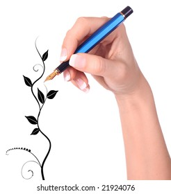 Hand with fountain pen drawing floral tree on white background
