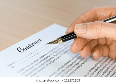 Hand with Fountain Pen Signing a Contract