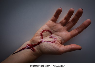 Hand full of blood and wrist cut. suicide of unhappy love