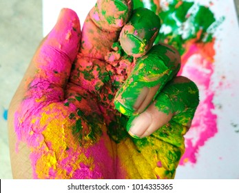 Hand full of colours during Holi festival of India