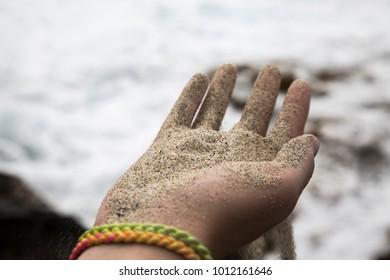 Hand full of sand on beach