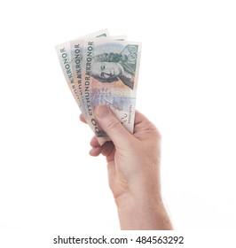 Hand full of Swedish kronor