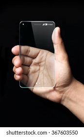 Hand and futuristic transparent smartphone isolated on black background. The most promising technologies in the mobile market is flexible and transparent displays.