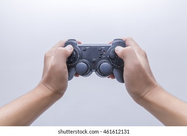 Hand with gamepad isoated on white background