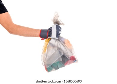 hand with garbage bag  in front of light background