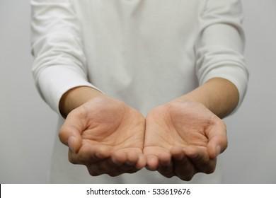 Hand gesture of giving open hands