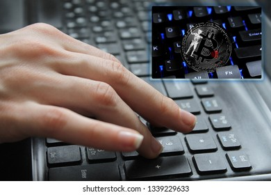 Hand of the girl on the keyboard close up with the concept of digital technology on the purchase and sale of crypto currency bitcoin with a flag of Blackbeard Pirate. The concept of network