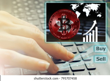 Hand of the girl on the keyboard close up with an abstract futuristic screen hologram, the concept of digital technology on the purchase and sale of crypto currency bitcoin with a flag of Hong Kong
