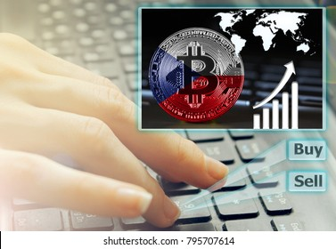 Hand of the girl on the keyboard close up with an abstract futuristic screen hologram, the concept of digital technology on the purchase and sale of crypto currency bitcoin with a flag of Czech