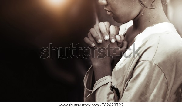 Hand girl praying in the church in vintage tone, Hands folded in prayer concept for faith, spirituality and religion, Coronavirus quarantine concept, food children donation