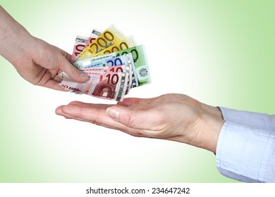 Hand gives money in open hands