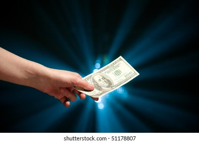 hand giving a 100 dollars banknote